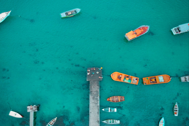 drone aerial view of boats on the sea